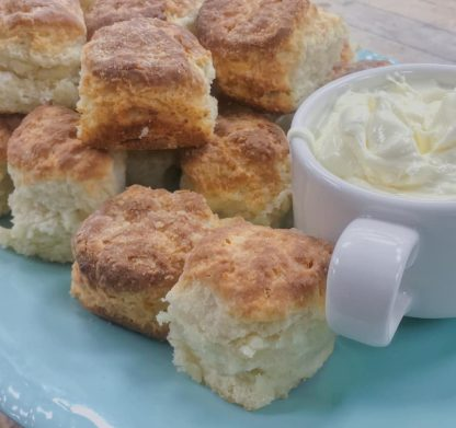 Roadhouse Biscuits with a cup of whipped butter