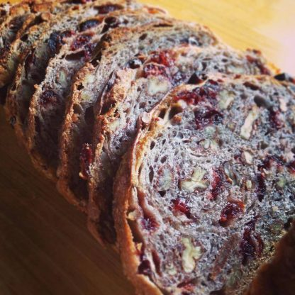 Cranberry Pecan Bread Slided on a Cutting Board
