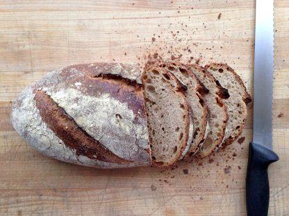 True North Bread on a cutting board, Half sliced